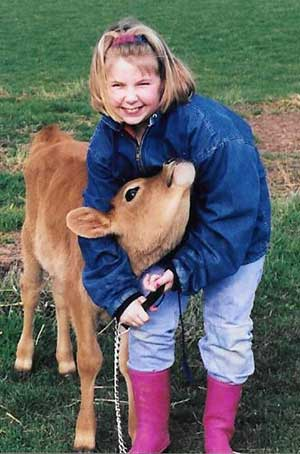 Little girl with Jersey calf